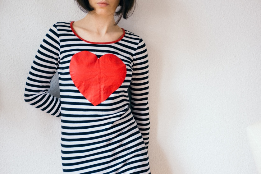Girl with a heart on a shirt